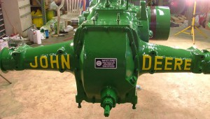 Restored tractor engine, complete with decals and a professional paint job.
